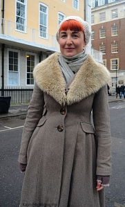 It is everything about her Coat .